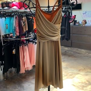 tan and brown colored ballet or dance costume